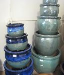"Glazed pots rainging in size from 24"" down to 16"""