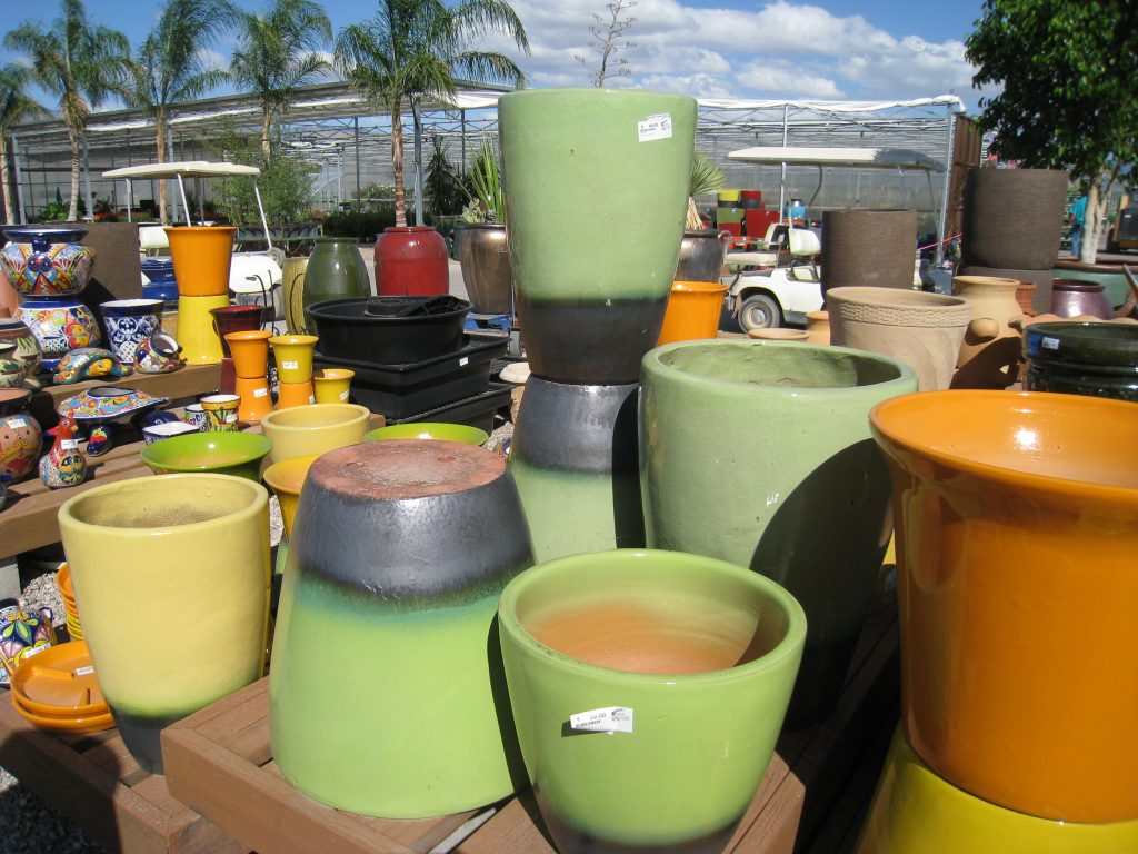Yard of dozens of pots for desert garden