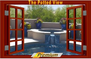 Looking out at a pool bordered by desert container winter gardens.Potted Desert