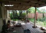 Messy Patio with out of date pots